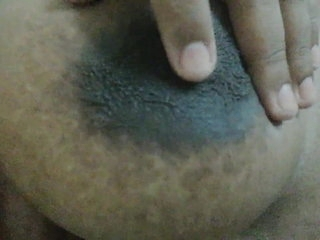 Horny Tamil girl pinches her nipples and moans with audio