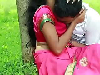 Couple kissing in the park